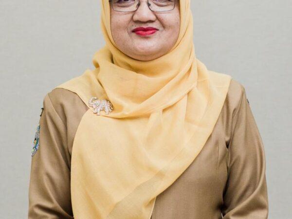 Dra. Hj. Tri Wahyuti